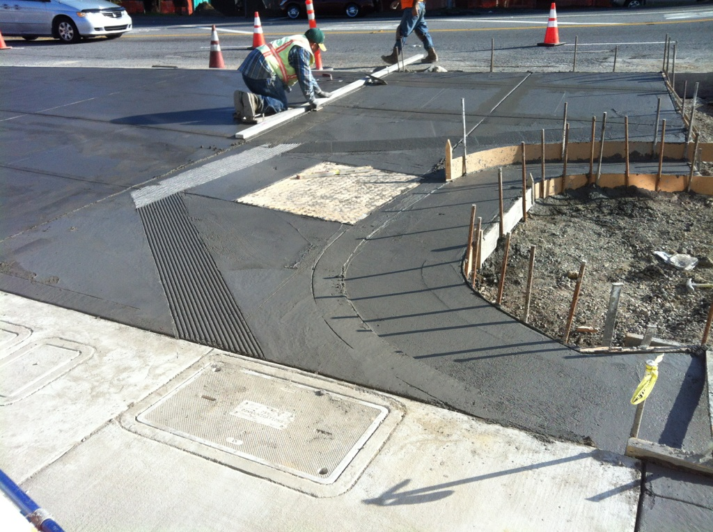 new curb-cut with wider access to the ramp will accomodate cyclists and pedestrians traveling in opposite directions