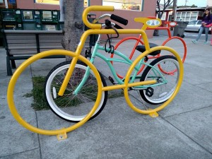 The racks by Boss Burger and the post office brighten up the corner and provide great bike parking!