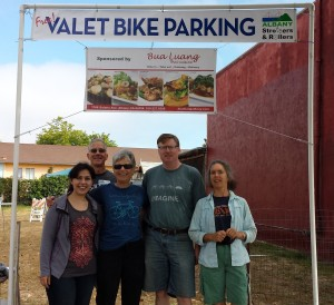 Volunteers Sara, Nick, Sylvia, Ken and Anne beneath the Bua Luang banner after a long & productive day of parking 300+ bikes!