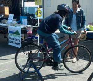Bicycle + fruit + blender = delicious fun!! Want to help like Tenisha is doing here? Email Ken! Photo courtesy Amy Smolens