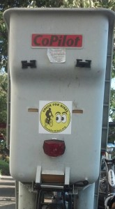 "A bike child seat is the perfect place to put a ""Check for Bikes"" bumper sticker!"
